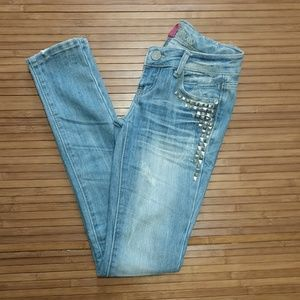 Studded and distressed blue jeans